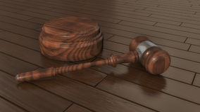 Judge`s gavel and parquet flooring Royalty Free Stock Images