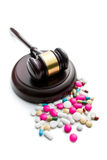 Judge's gavel with pills Royalty Free Stock Photography