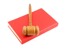 Judge's gavel on red legal book isolated Royalty Free Stock Photos