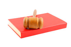 Judge's gavel on red legal book isolated Stock Photos