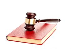 Judge's gavel on red legal book Stock Image