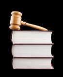 Judge's gavel and stack of legal books Stock Photo