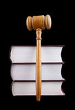 Judge's gavel and stack of legal books Royalty Free Stock Image