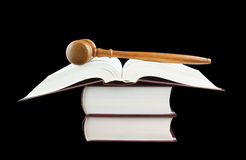 Judge's gavel and stack of legal books Royalty Free Stock Photo