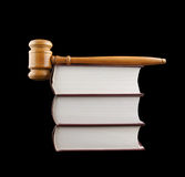 Judge's gavel and stack of legal books isolated Royalty Free Stock Image