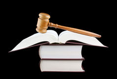 Judge's gavel and stack of legal books isolated Royalty Free Stock Photo
