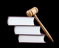 Judge's gavel and stack of legal books isolated Stock Images