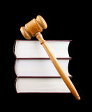 Judge's gavel and stack of legal books isolated Stock Photo