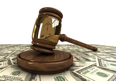 Judge's gavel standing on a dollars Stock Photos