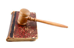 Judge's gavel and very old legal book Royalty Free Stock Photo