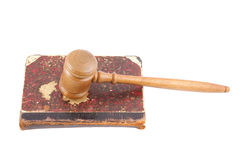 Judge's gavel and very old legal book Royalty Free Stock Image
