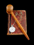 Judge's gavel and very old legal book Stock Image