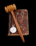 Judge's gavel and very old legal book with watch Royalty Free Stock Photography