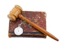 Judge's gavel and very old legal book with watch Royalty Free Stock Image