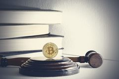 Judge`s hammer and bitcoin gold coin. Digital currency.  stock images