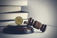 Judge`s hammer and bitcoin gold coin. Digital currency.  stock photography