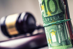 Judge's hammer gavel. Justice and euro money. Euro currency. Court gavel and rolled Euro banknotes. Royalty Free Stock Photography