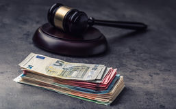 Judge's hammer gavel. Justice and euro money. Euro currency. Court gavel and rolled Euro banknotes. Representation of corruption and bribery in the judiciary stock photography