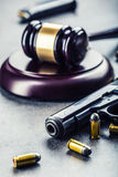 Judge's hammer gavel. Justice and gun. Justice and the judiciary in the unlawful use of of weapons. Judgment in murder Royalty Free Stock Image