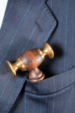 Judge's hammer in a pocket Stock Photos
