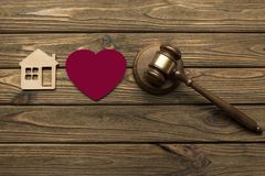 A judge`s hammer, a red heart
