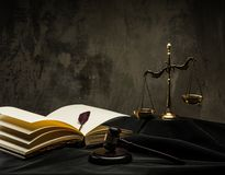 Judge's mantle still-life. Scales and wooden hammer on judge's mantle Royalty Free Stock Image