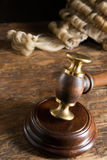 Judge's wig and hammer. Judge's horsehair wig and his gavel or hammer royalty free stock photos
