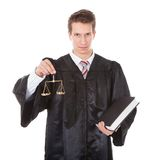 Judge with scales and book Royalty Free Stock Images