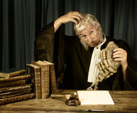 Judge scratching head. Old judge scratching his head in court royalty free stock photos