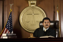 Judge Sitting In Courtroom Royalty Free Stock Photography