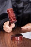 Judge striking the gavel in a courtroom Royalty Free Stock Image