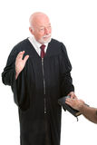 Judge - Swearing In. Judge swearing in a witness on the Holy Bible.  Isolated on white Royalty Free Stock Photography