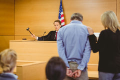 Judge about to bang gavel on sounding block Royalty Free Stock Photography
