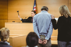 Judge about to bang gavel on sounding block Stock Photos