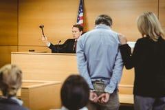 Judge about to bang gavel on sounding block stock photos