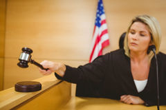 Judge about to bang gavel on sounding block Stock Photography