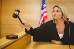 Judge about to bang gavel on sounding block Royalty Free Stock Photos