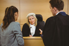 Judge wearing dress and wig listening lawyers Royalty Free Stock Photos