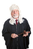 Judge Wearing Wig. British style judge wearing a wig.  Isolated on white Stock Image