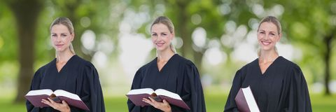 Judge woman holding a book collage against park background. Digital composite of Judge woman holding a book collage against park background Stock Images