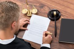 Judge Writing On Paper Stock Image