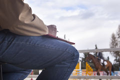 Judge writting down while a rider performs at horse jumping comp Royalty Free Stock Photo