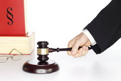 Judgement symbol. Symbolic judgement with gavel in hand and books Stock Images