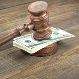 Judges or Auctioneer Gavel And Dollars Cash On  Wooden Table. Judges or Auctioneer Gavel, Soundboard And Bundle Of Dollar Cash On The Rough Wooden Textured Table Royalty Free Stock Photography
