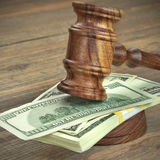 Judges or Auctioneer Gavel And Dollars Cash On  Wooden Table Royalty Free Stock Photos