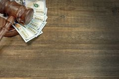 Judges or Auctioneer Gavel And Money On The Wooden Table Royalty Free Stock Photos