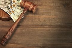 Judges or Auctioneer Gavel And Money On The Wooden Table Stock Photography