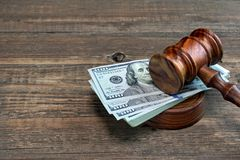 Judges or Auctioneer Gavel And Money On The Wooden Table Royalty Free Stock Images