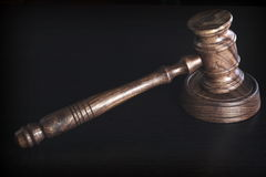 Judges Or Auctioneer Wooden Gavel Or Hammer On Black Table. Judges Or Auctioneer Wooden Gavel Or Hammer On Grunge Black Table, Top View, Close Up Stock Photo
