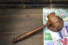 Judges Or Auctioneers Gavel, Dollars, Euro, Pounds On Wood Table Royalty Free Stock Photos